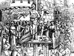 Humanistisch theoloog William Tyndale als ketter op de brandstapel.